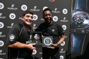 Diego Armando Maradona, retired Argentine professional footballer and coach (L) and Edson Arantes do Nascimento, known as Pelé, retired Brazilian professional footballer and coach show a Hublot watch during the football match of friendship with Pelé and Maradona sponsored by Hublot in Paris, France on 9th of June 2016.